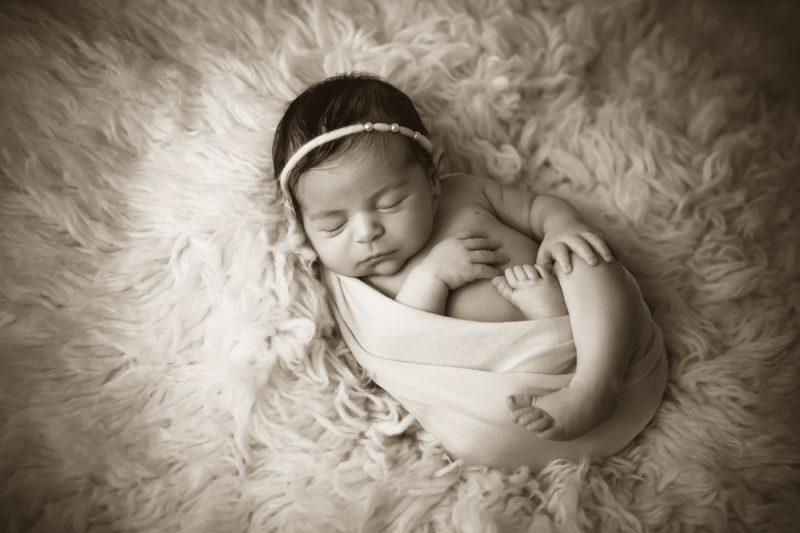 Swaddled, Sleeping Newborn Baby Girl