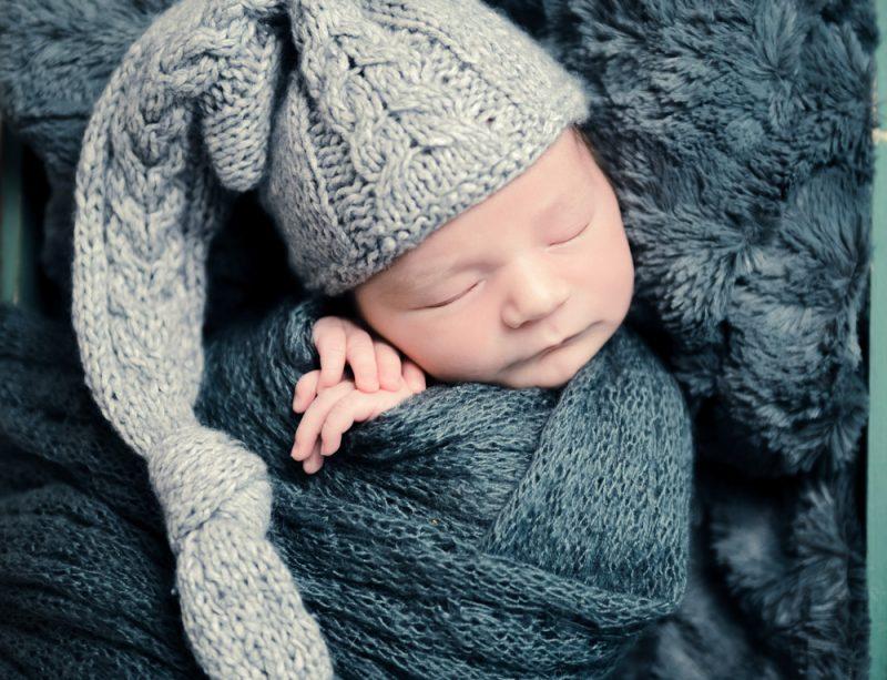 Cute child sleeping in hat, closeup