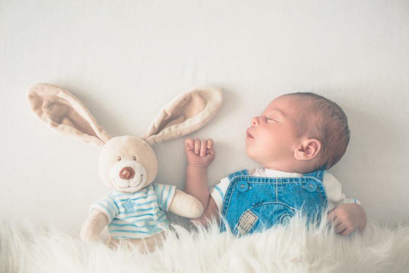Fashionable little newborn baby boy, sleeping in the afternoon a