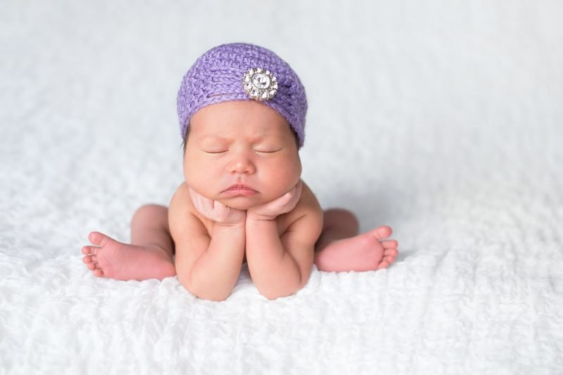 Newborn Baby Girl Wearing a Lavender Flapper Hat